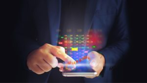 Smart phone user with stock hologram